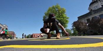 Co-lead artist for BLM street mural project, Raheem Elmore.
