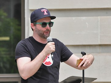Gabe Gloden, managing director of the Cardinal Stage, addresses the crowd on Saturday.
