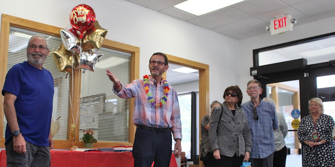Jack Davis, wearing his Election Day shirt and a lei, addresses the group assembled to honor his retirement on Thursday.