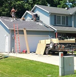 picture of a baby blue house that is getting insurance restoration in medina ohio work done by brightside restoration