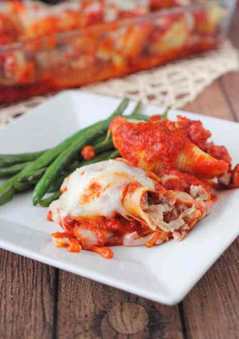 Stuffed Pasta Shells covered in fresh Mozerella Cheese