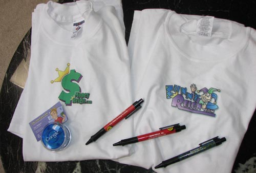 super affiliate zac johnson delivers two t-shirts, a yo-yo, three pens, and a business card