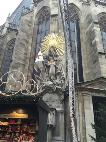 The 18th century Baroque statue shows St. Francis under an extravagant sunburst, trampling on a beaten Turk.