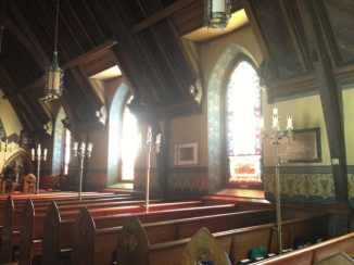 Light streams through Christ Church's stained glass windows. Photo by Kate Abbott