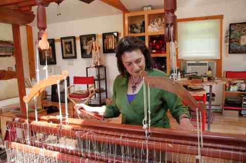 Wendy Rabinowitz works at her loom. Photo courtesy of Susan Geller.