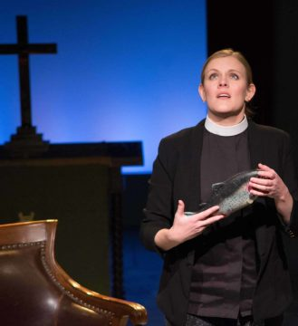 Amie Lytle as Abigail faces her first congregation in 'Holy Laughter.' Photo by Enrico Spada, Courtesy of WAM Theatre