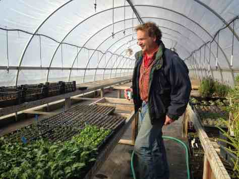 Joe Gilbert shows a greenhouse in winter. Photo by Kate Abbott