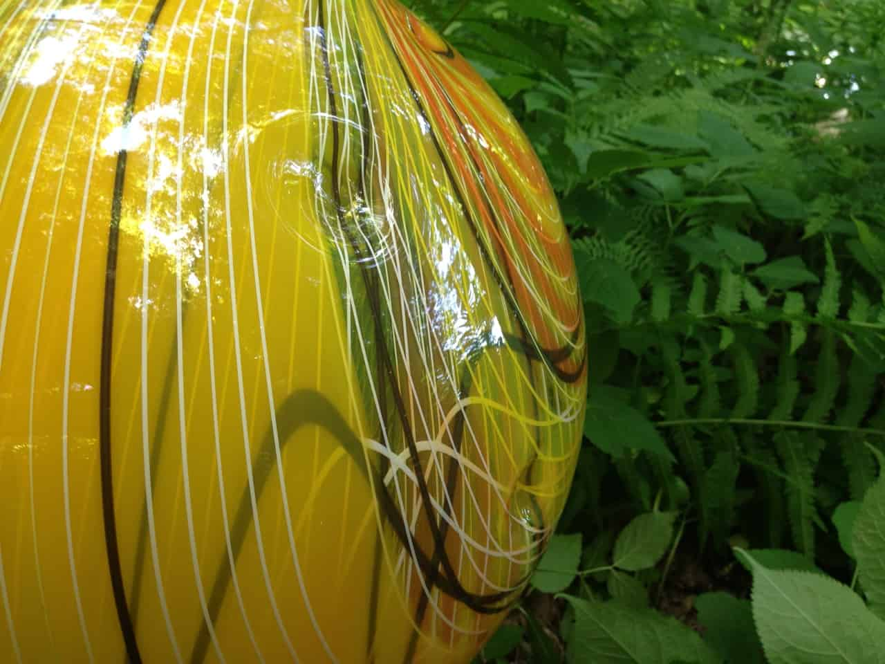"Nancy Callan's glass orbs in bright colors gleam in the ferns in ""Julia's Garden."" Photo by Kate Abbott"