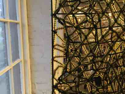 A screen of beads stretches across the second storey. Photo by Kate Abbott