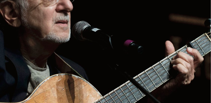 Peter Yarrow, singer / songwriter of Peter, Paul and Mary, strums his guitar.