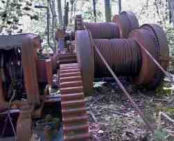 Steam winch manufactured June 10, 1890 as it was left with cables still intact powered the derrick to remove large quarry blocks of granite. Photo by Thom Smith