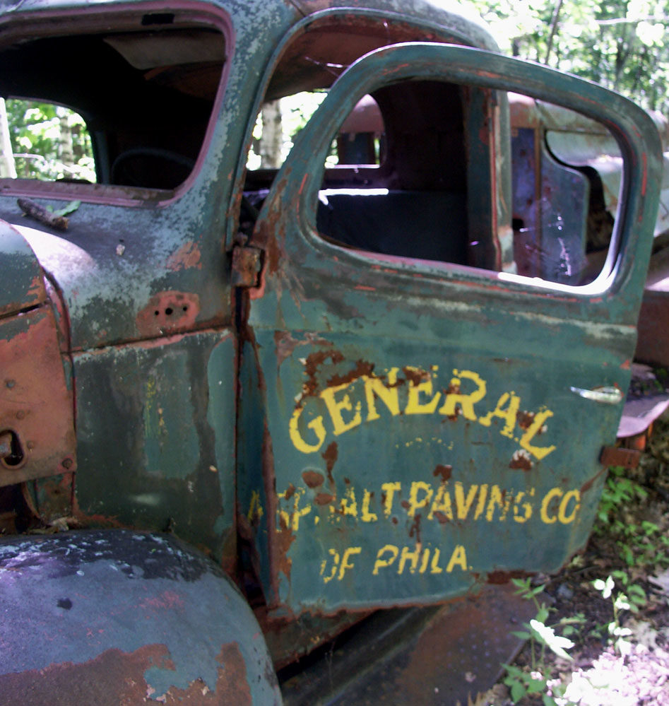 An asphalt truck shows a company name still legible after more than half a century. Photo by Thom Smith