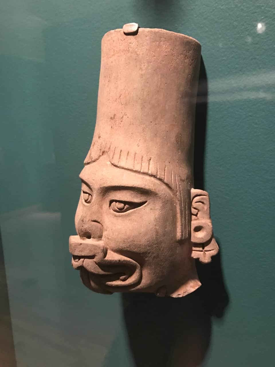 A Zapotec figure wears a supernatural face mask. It was made in Oaxaca c. 100 CE. On loan from the Worcester Art Museum. Photo by Kate Abbott