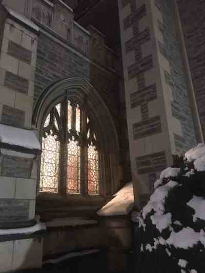 Thompson Chapel at Williams College shines a warm light on a snowy night. Photo by Kate Abbott