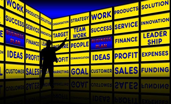 Herstructurering Fusie Overname Target Strategie Businessplan Monitor Wall Presentatie Zakenman