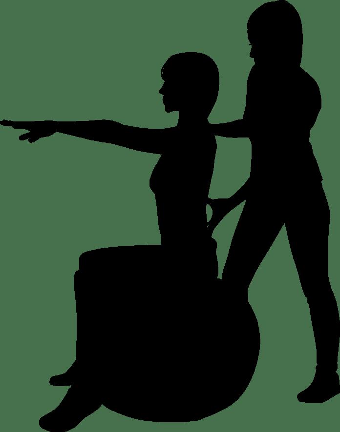 silhouet van chiropractor met patient op bal