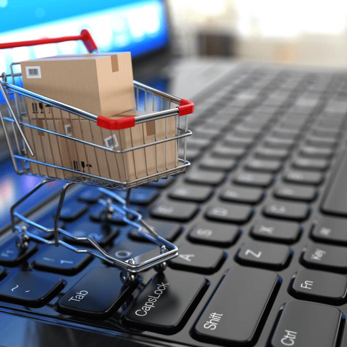 E-commerce elektronische handel winkelwagentje op toetsenbord