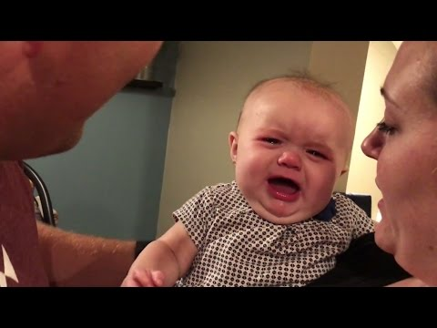 Baby gets jealous when parents kiss!