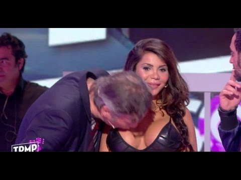Man kisses her breasts on national television!