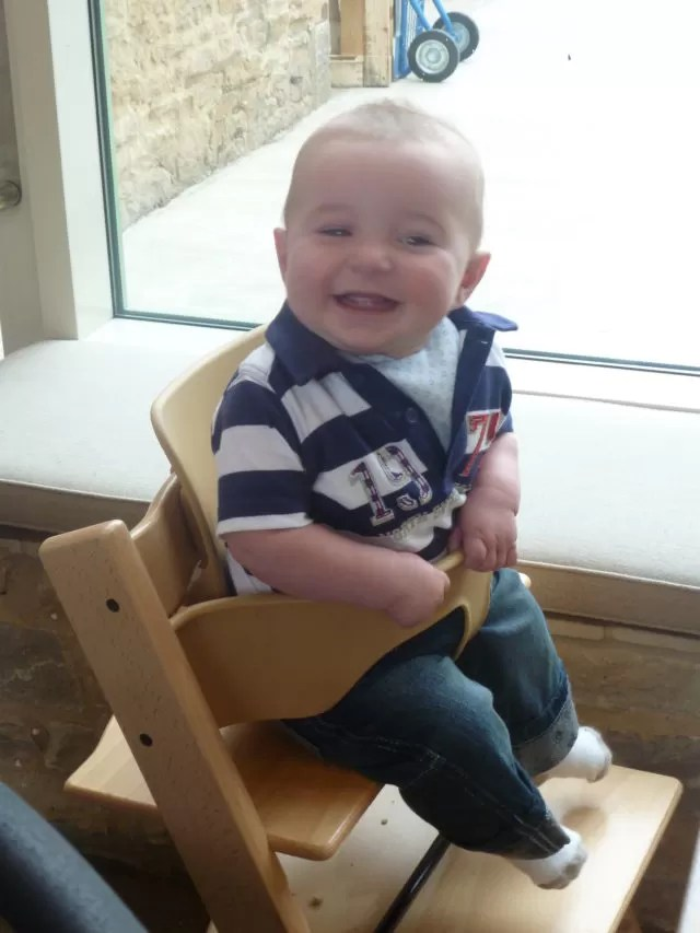 sitting in the highchair at Daylesford