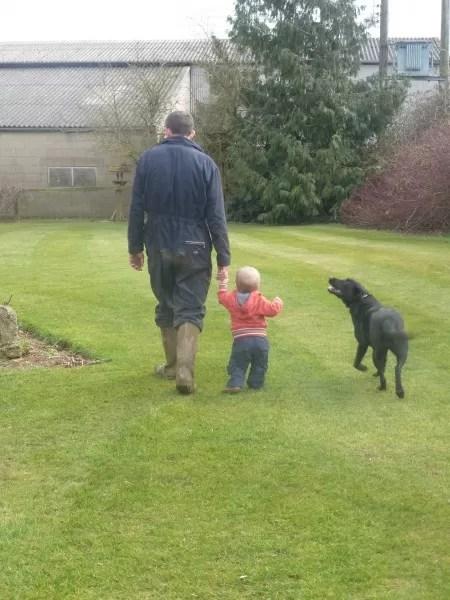 Man, boy and dog