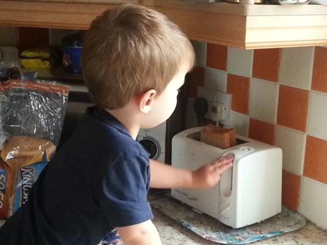 toddler making toast