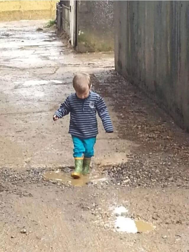 toddler walking in puddles (1)