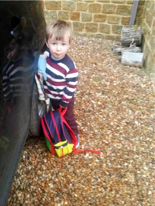 toddler with rucksack ready for day nursery (1)