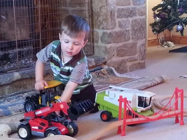 playing with bruder tractors.