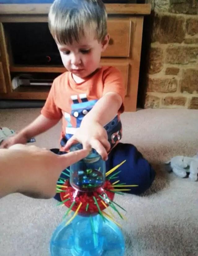 toddler playing kerplunk (1)