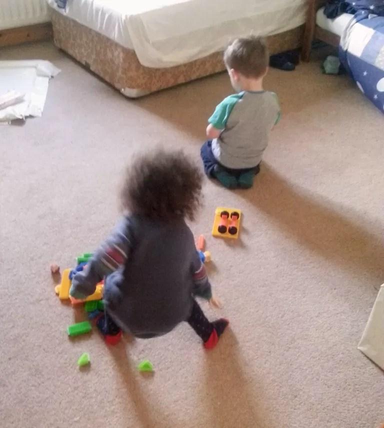 toddlers playing sticklebricks