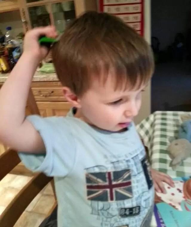 boy combing hair