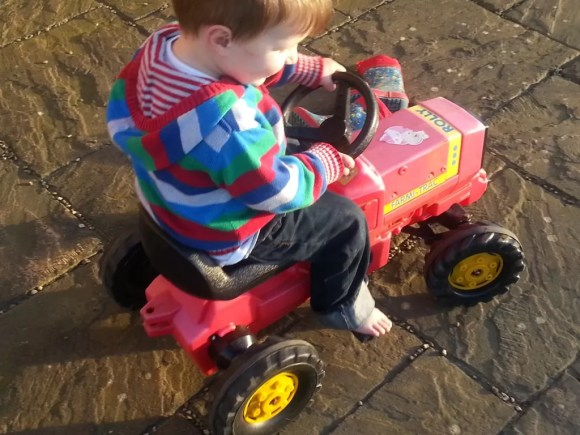 barefeet pedalling a tractor