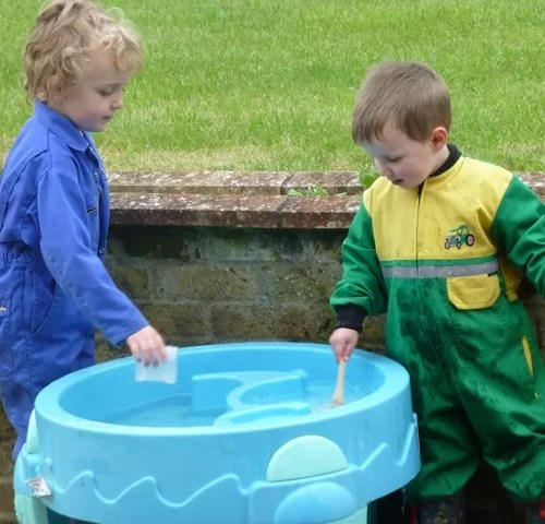 two boys water play