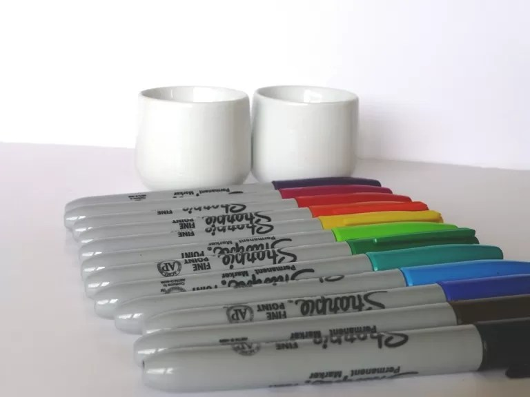 sharpies and egg cups for decorating
