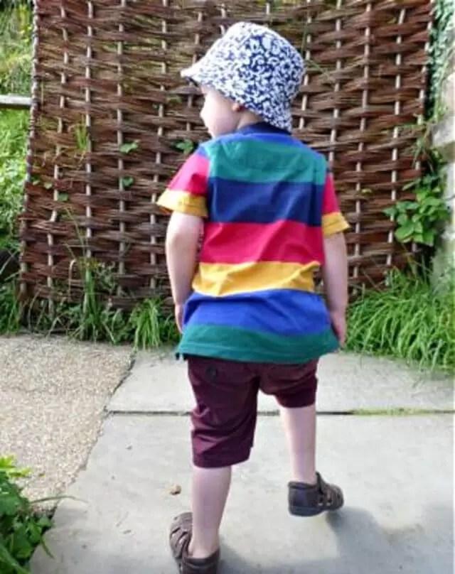 boy in rainbow t shirt