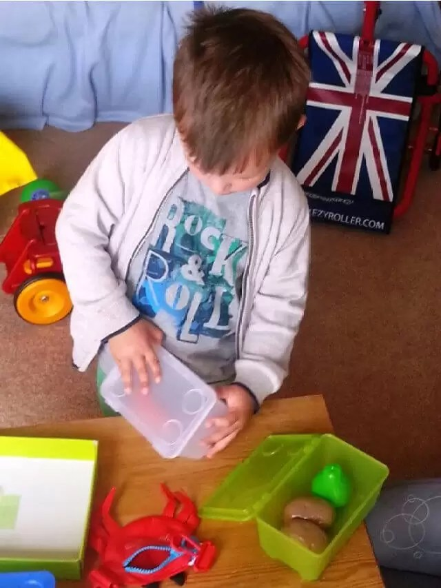 setting-up-his-play-shop.
