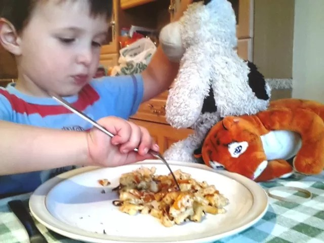 macaroni cheese - eating with toys