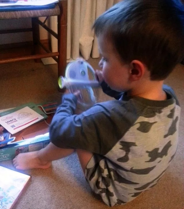 playing with the magical book reader