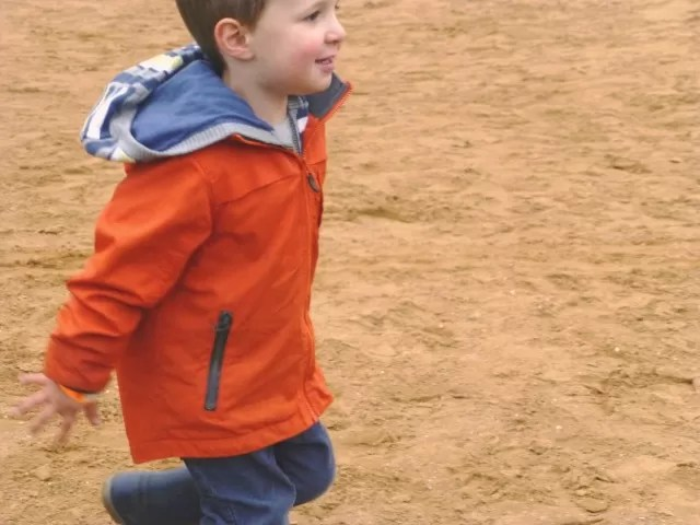 running and playing ball on the volleyball court at Hatton Adventurre World