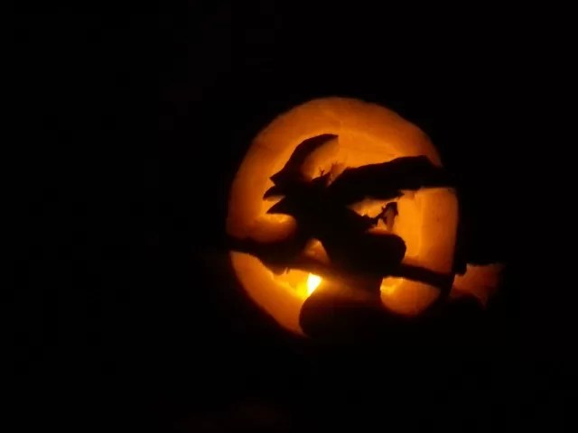 witch on a broom pumpkin