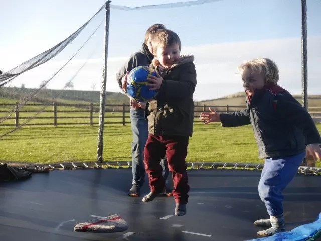trampoline bouncing with a ball