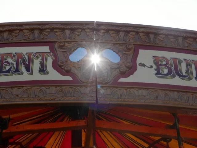 fairground ride and sun