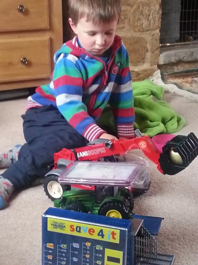 piling up the farm vehicle toys