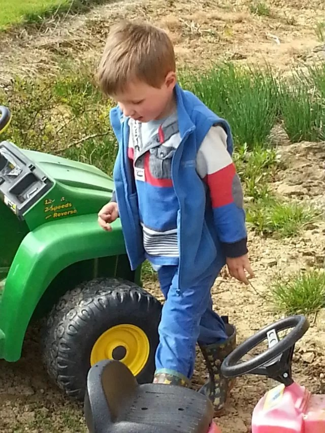 playing in the garden with his gator
