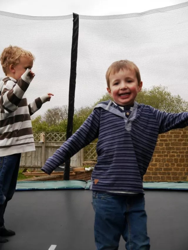 kids bouncing on a trampoline