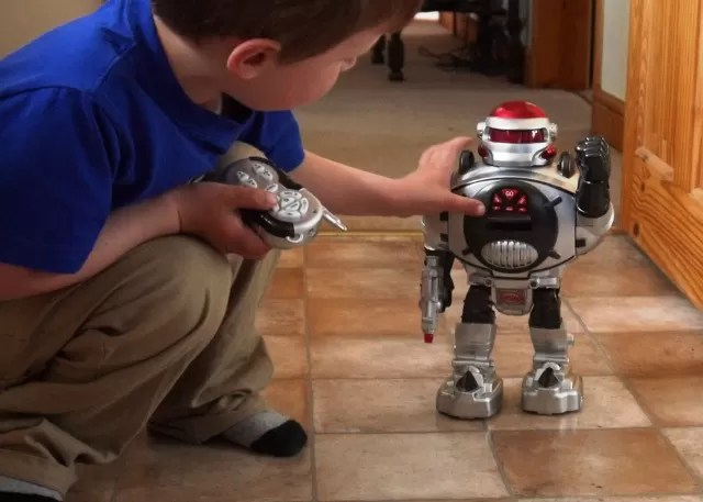 Playing with the remote control toy robot
