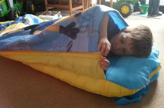 cocooned in his Despicable me minions readybed