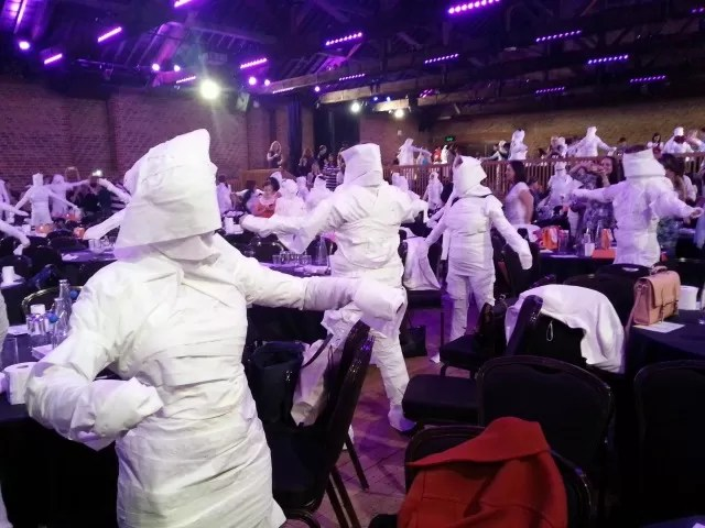 roomful of toilet paper wrapped mummies