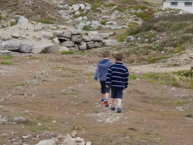 2 boys exploring Portland Bill rocks